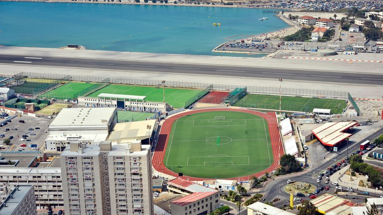 A general view of the Gibraltar runway with football pitches and sports facilities below.