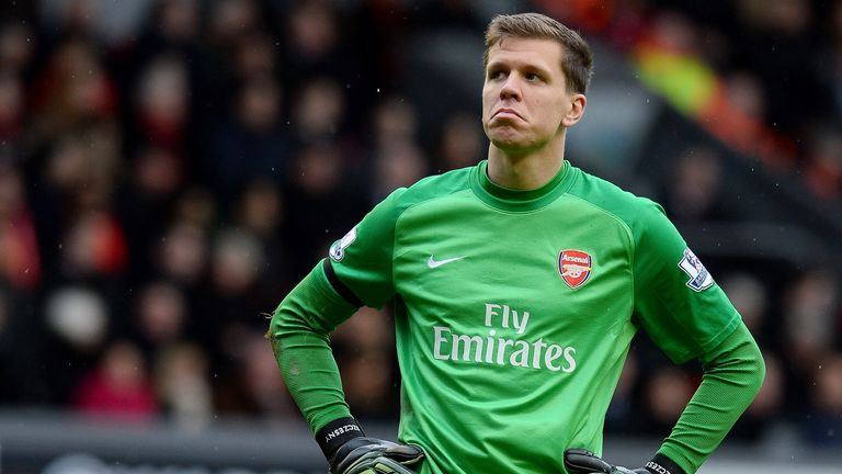 Arsenal's Polish goalkeeper Wojciech Szczesny reacts during the English Premier League football match between Liverpool and Arsenal at Anfield in Liverpool