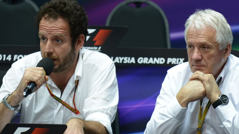 Charlie Whiting (R) believes standing restarts won't create additional risks