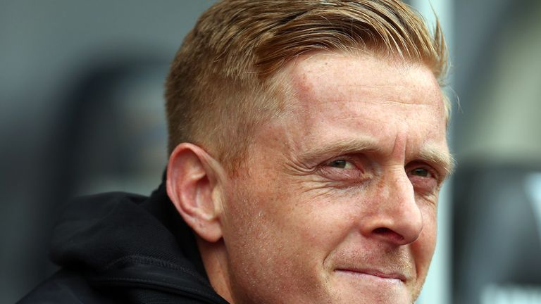 Swansea manager Garry Monk has signed striker James Demetriou on a two-year deal.