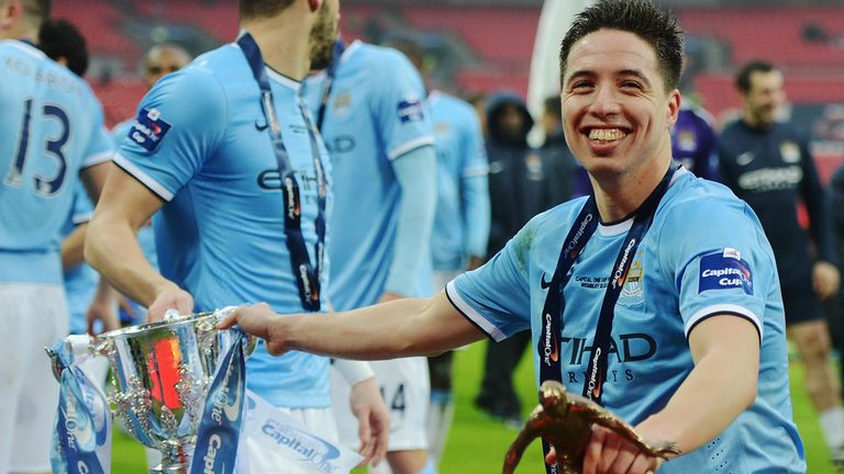 Samir Nasri helped Manchester City to a league and cup double in 2014