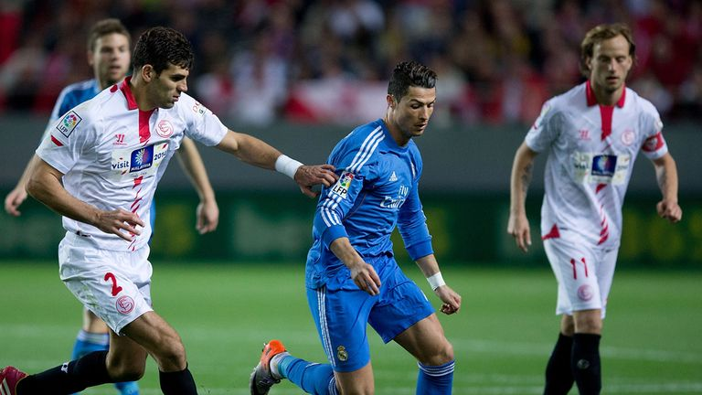Cristiano Ronaldo (2L) of Real Madrid CF competes for the ball with Sevilla players