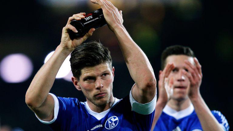 Klaas-Jan Huntelaar of Schalke 04 applaudes his teams fans after the Bundesliga match between Borussia Dortmund and FC Schalke