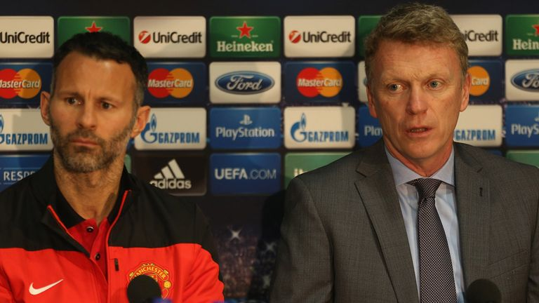 David Moyes of Manchester United speaks at a press conference alongside Ryan Giggs