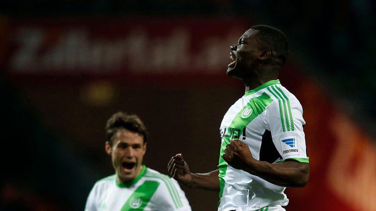 Junior Malanda of Wolfsburg celebrates after scoring his team's first goal during the Bundesliga match between Werder Bremen and Wolfsburg