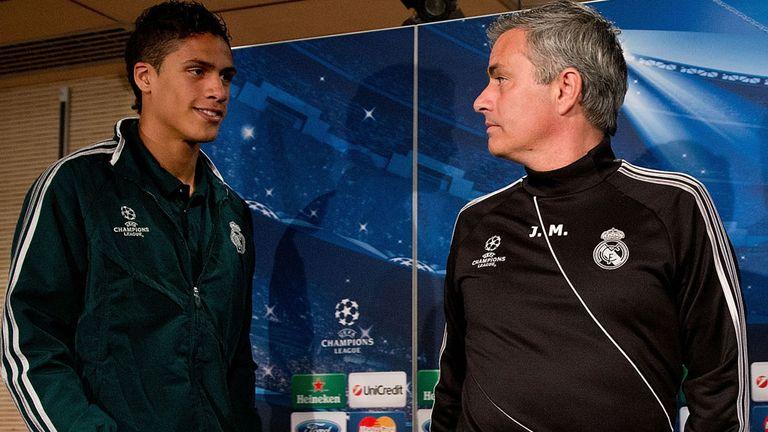 MADRID, SPAIN - APRIL 02:  Head coach Jose Mourinho (R) and Real Madrid player Raphael Varane