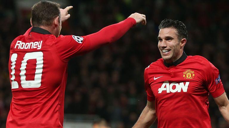 Robin van Persie of Manchester United celebrates scoring their second goal against Olympiakos