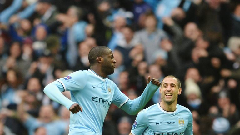 City equaliser: Yaya Toure celebrates his goal with Pablo Zabaleta after floating a shot into the top corner