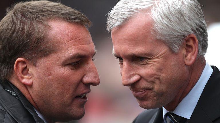 Swansea City manager Brendan Rodgers (left) chats with Newcastel United manager Alan Pardew