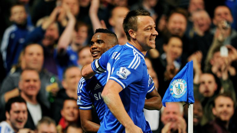 LONDON, ENGLAND - MARCH 08:  Samuel Eto'o of Chelsea is congratulated by teammate John Terry after scoring his team's first goal during the Barclays Premie