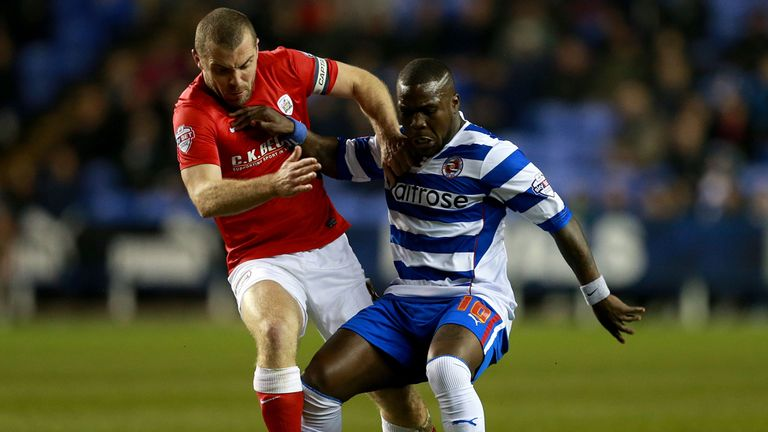 Reading's Royston Drenthe is tackled by Barnsley's Stephen Dawson during the Sky Bet Championship match at the Madejski Stadium, Reading.