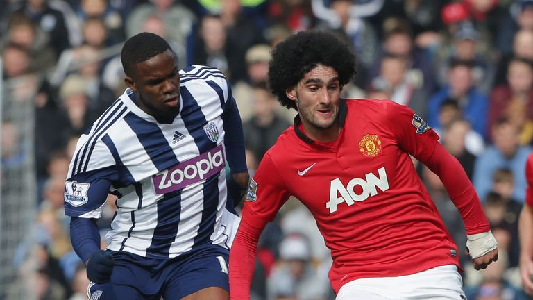 Marouane Fellaini holds off Victor Anichebe as Manchester United take on West Brom at the Hawthorns.