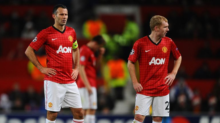 Legends Ryan Giggs (L) and Paul Scholes (R) were still at United when Pogba decided to join Juventus