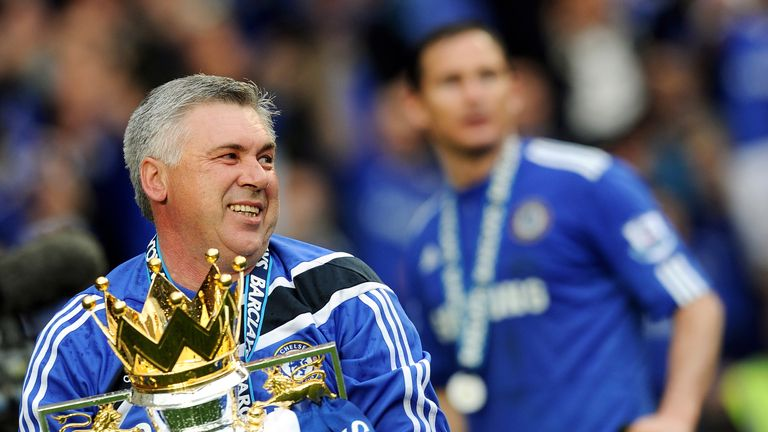 Chelsea manager Carlo Ancelotti celebrates with the Barclays Premier League trophy after Chelsea win the title in 2010.