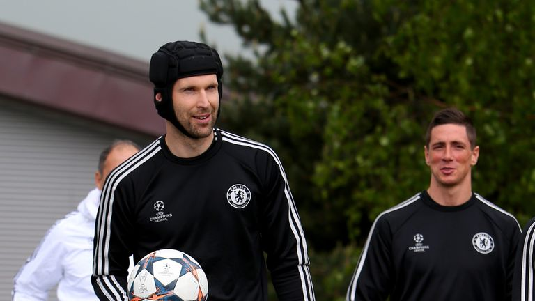 COBHAM, ENGLAND - APRIL 29:  Petr Cech of Chelsea walks out to the pitch prior to a training session at Chelsea Training Ground on April 29, 2014 in Cobham