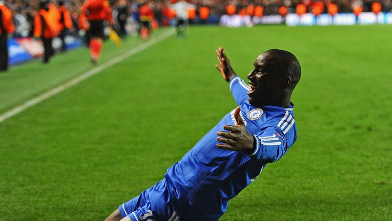 Demba Ba slides towards the Chelsea fans after sending them into the Champions League semi-finals