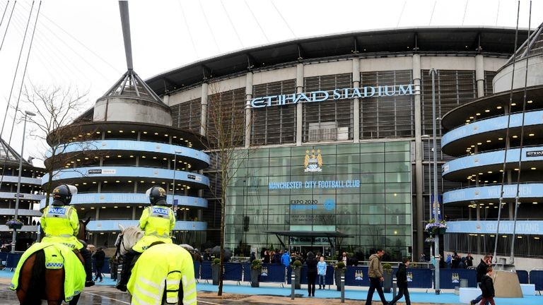 The fans slowly made their way into the Etihad Stadium on a wet afternoon in Manchester