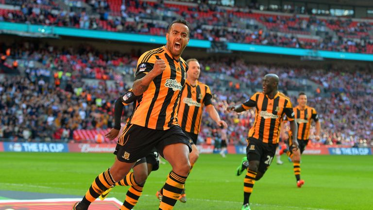 LONDON, ENGLAND - APRIL 13:  Tom Huddlestone of Hull City celebrates scoring their third goal during the FA Cup with Budweiser semi-final match between Hul