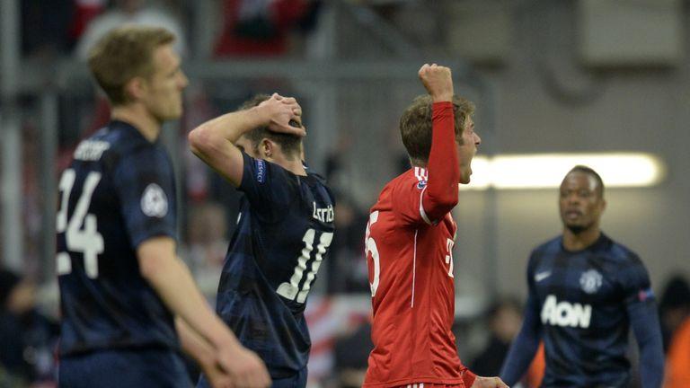 Bayern Munich's midfielder Thomas Mueller (C) reacts after scoring a goal during the UEFA Champions League quarter-final second leg football match Bayern M