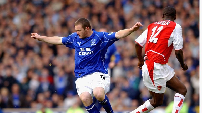 Wayne Rooney of Everton holds off Lauren of Arsenal at Goodison Park in 2002
