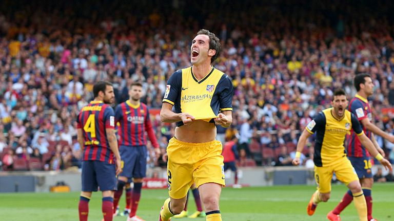 Diego Godin celebrates his title-winning goal at the Nou Camp in 2014