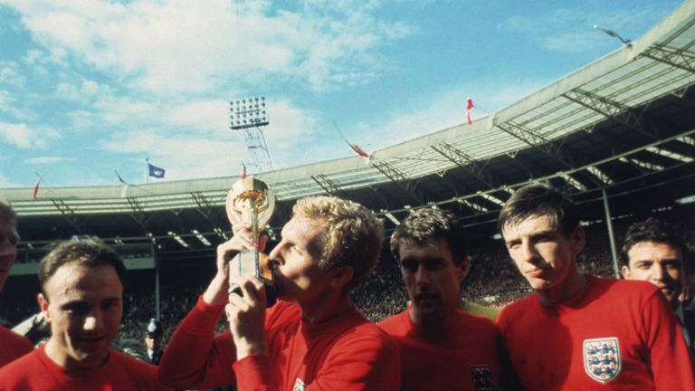England captain Bobby Moore kissing the Jules Rimet trophy as the team celebrate winning the 1966 World Cup final against Germany at Wembley Stadium. His t