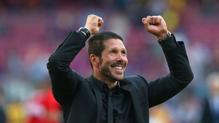 Diego Simeone the coach of Club Atletico Madrid celebrates towards his supporters after winning the La Liga after the match with Barcelona
