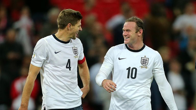 *Alternative Crop* England's Steven Gerrard (left) and Wayne Rooney (right) celebrate victory after the final whistle