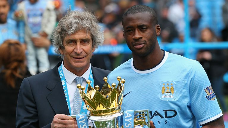 Manuel Pellegrini and Yaya Toure pose with the Premier League trophy