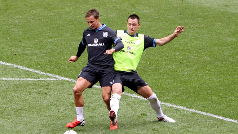 Phil Jagielka is challenged by John Terry during an England training session at Wembley Stadium on June 1, 2012