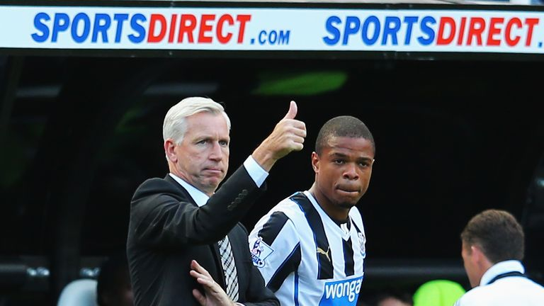 NEWCASTLE UPON TYNE, ENGLAND - AUGUST 31:  Newcastle United manager Alan Pardew signals as Loic Remy prepares to come on during the Barclays Premier League