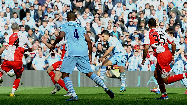 Manchester City's Argentinian striker Sergio Aguero (3rd R) scores their late winning goal during the English Premier League football match between Manches