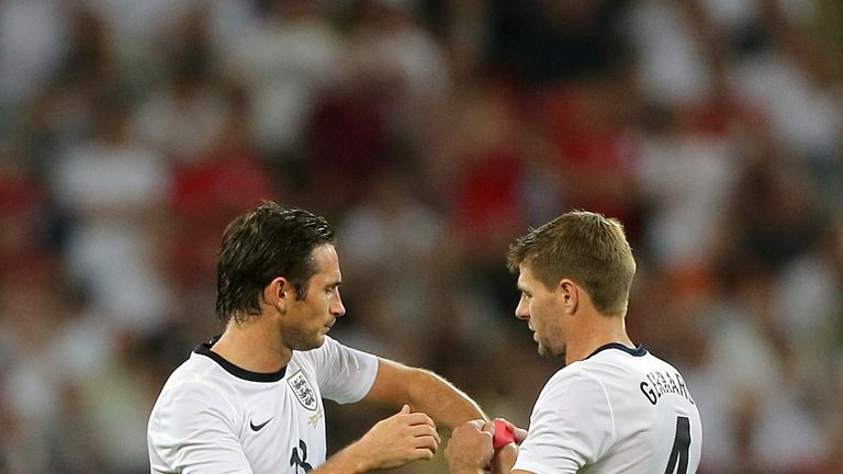 England's captain Steven Gerrard (right) hands the captain's armband over to team-mate Frank Lampard