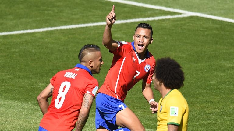 Chile forward Alexis Sanchez (C) celebrates after scoring a goal during the World Cup Round of 16 football match between Brazil and Chile in Belo Horizonte
