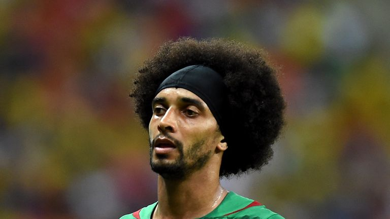 Cameroon's defender Benoit Assou-Ekotto walks on the pitch during the Group A football match between Cameroon and Croatia at The Amazonia Arena in Manaus
