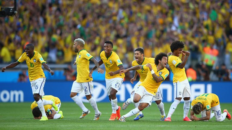 BELO HORIZONTE, BRAZIL - JUNE 28: Brazil celebrate after defeating Chile in a penalty shootout during the 2014 FIFA World Cup Brazil round of 16 match