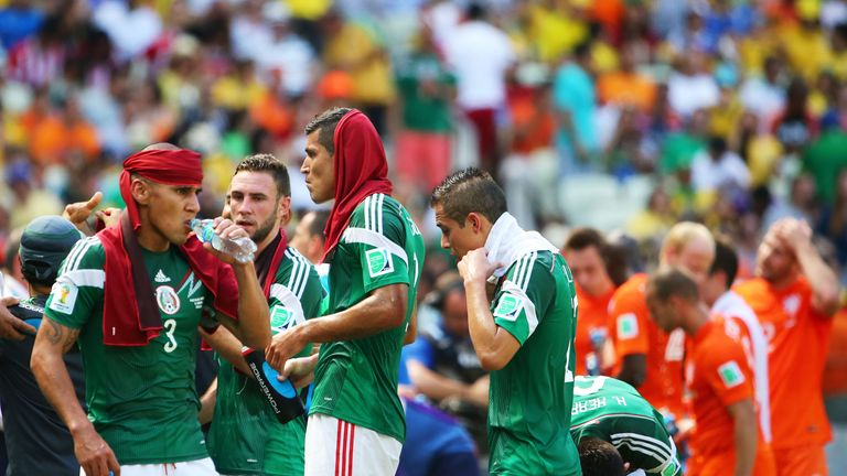 Carlos Salcido of Mexico takes on fluids during a cooling break in the 2014 FIFA World Cup Brazil Round of 16 match v the Netherlands