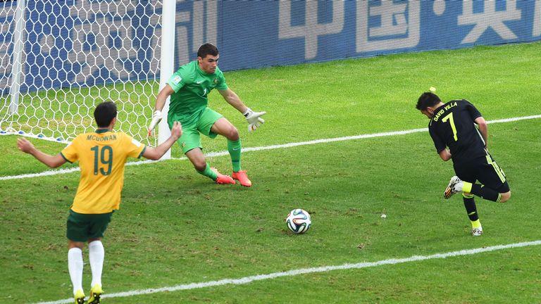 CURITIBA, BRAZIL - JUNE 23:  David Villa of Spain scores his team's first goal with a back heel past Mathew Ryan of Australia during the 2014 FIFA World Cu