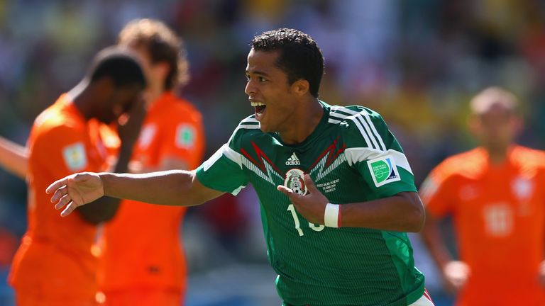 Mexico's Giovani dos Santos of Mexico celebrates his goal during the World Cup last-16 clash v Netherlands in Fortaleza