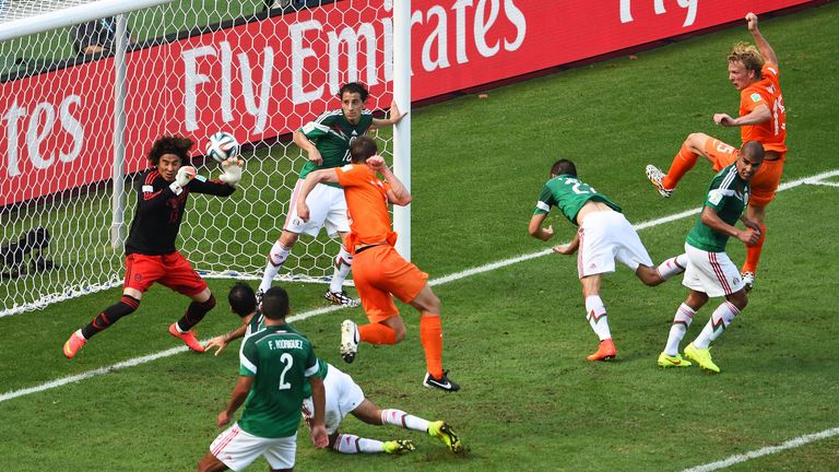 Mexico goalkeeper Guillermo Ochoa saves a shot by Stefan de Vrij of the Netherlands during the World Cup last-16 clash in Fortaleza