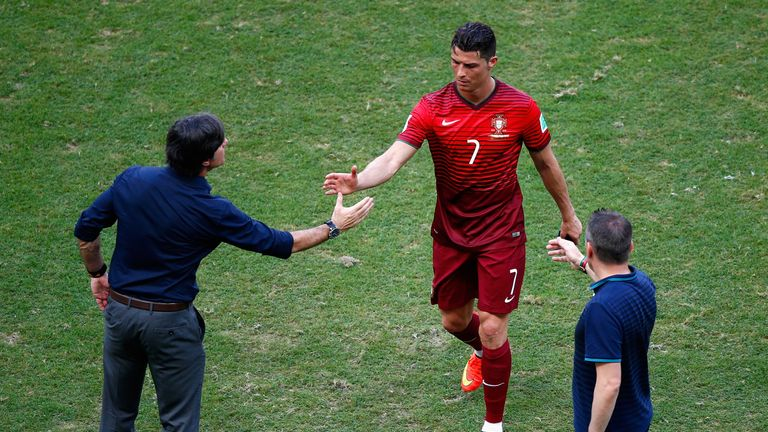 SALVADOR, BRAZIL - JUNE 16: Head coach Joachim Loew of Germany (L) shakes hands with Cristiano Ronaldo of Portugal as he leaves the field after the 2014 FI