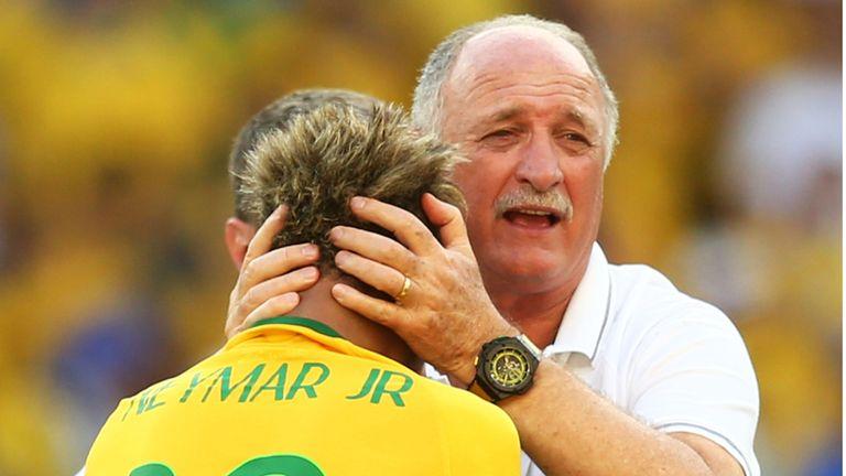 Head coach Luiz Felipe Scolari of Brazil celebrates with Neymar after defeating Chile in a penalty shootout