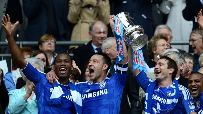 Frank Lampard lifts the 2012 FA Cup alongside John Terry and Didier Drogba