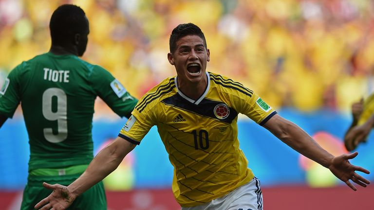 Colombia's midfielder James Rodriguez celebrates scoring during a Group C football match between Colombia and Ivory Coast