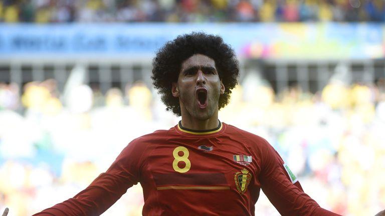 Belgium's midfielder Marouane Fellaini celebrates after scoring during a Group H football match between Belgium