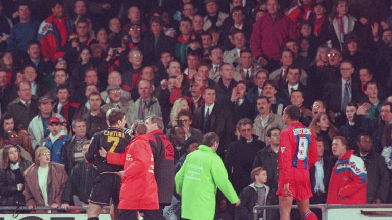 ERIC CANTONA OF MANCHESTER UNITED IS LED OFF THE PITCH AFTER FIGHTING WITH A FAN AFTER BEING SENT OFF DURING THE CRYSTAL PALACE V MANCHESTER