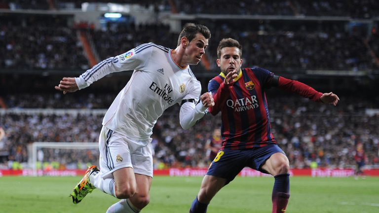 MADRID, SPAIN - MARCH 23:  Gareth Bale of Real Madrid takes on Jordi Alba of Barcelona during the La Liga match between Real Madrid CF and FC Barcelona at