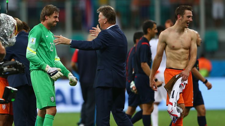 Tim Krul celebrates with head coach Louis van Gaal