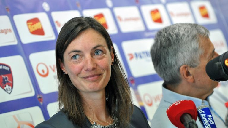 Corinne Diacre, the former captain of the French national women's football team, smiles at a Clermont Foot press conference