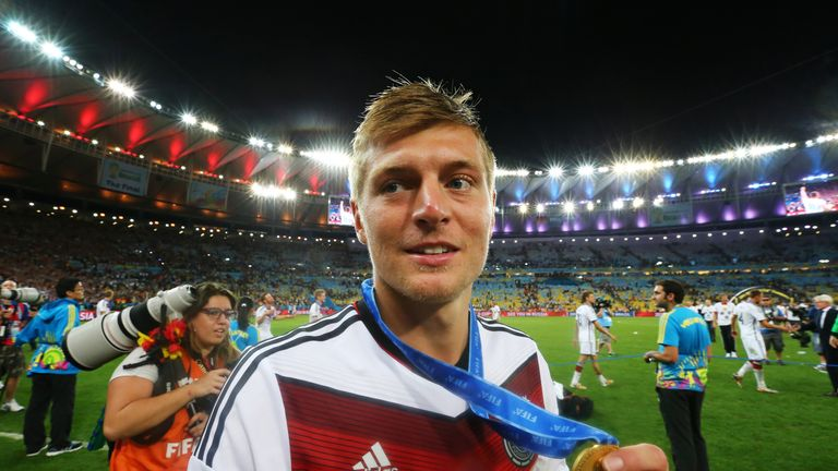 RIO DE JANEIRO, BRAZIL - JULY 13: Toni Kroos of Germany celebrates with his medal after defeating Argentina 1-0 in extra time during the 2014 FIFA World Cu